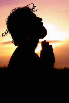 silhouette-image-of-person-praying-1615776